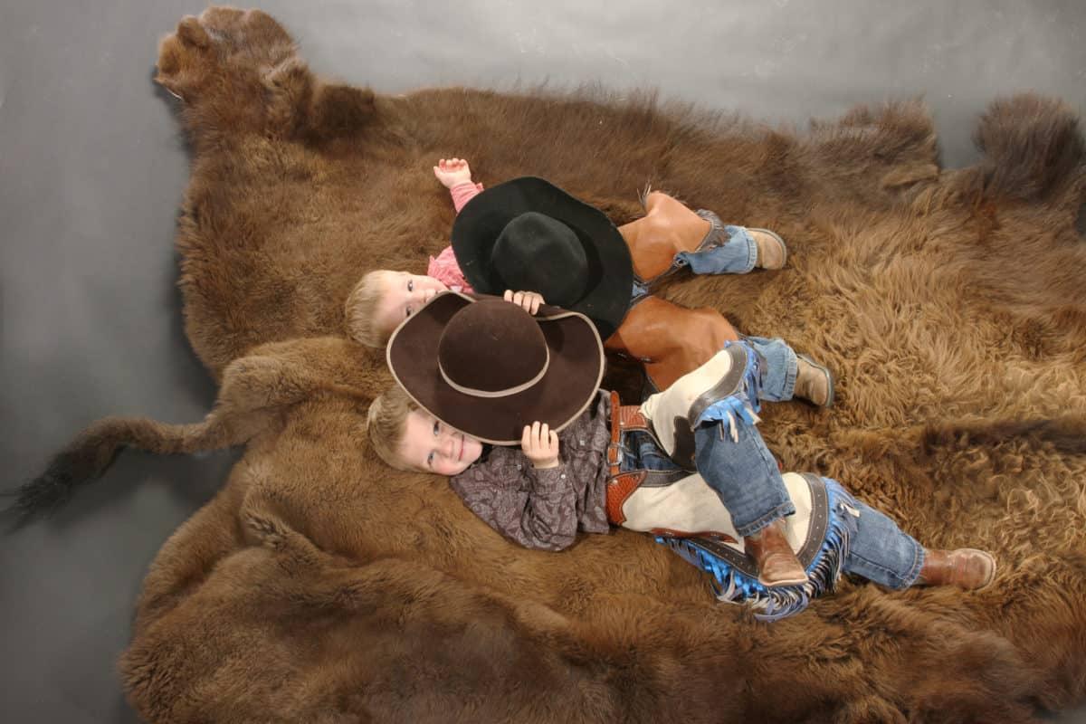 Boys on buffalo hide
