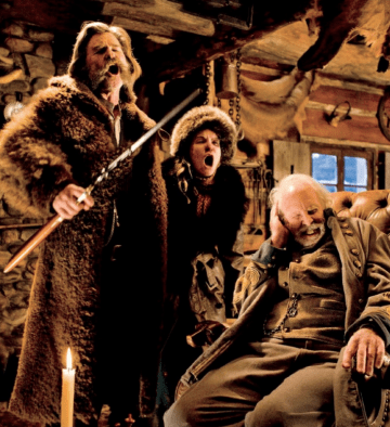 Kurt Russell wearing a buffalo fur coat in a scene from The Hateful Eight.