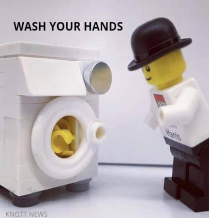 Wash your hands funny image with LEGO figurine washing its hands in a washing machine.