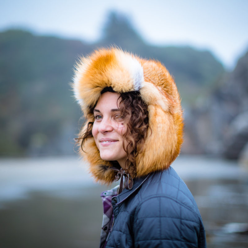 A friend of the Hide Out wears a Fox Fur hat on the Oregon coastline.